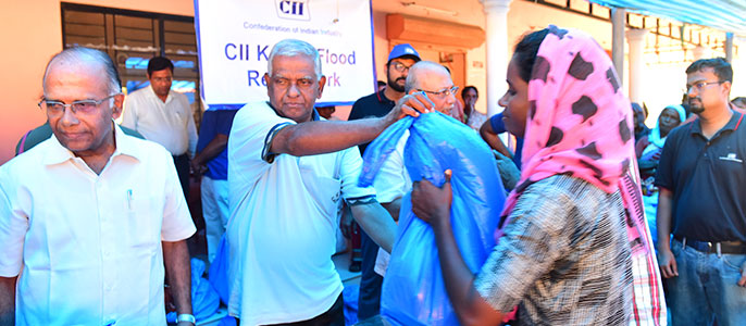Distribution of relief material to victims of Kerala Floods